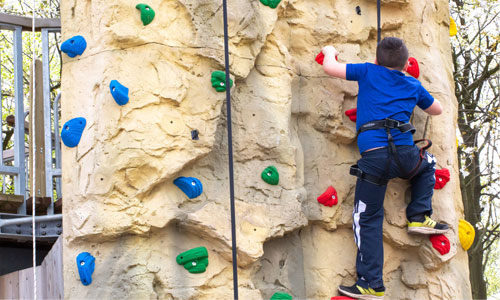 Picture of a child using the climbing wall at Sky Reach